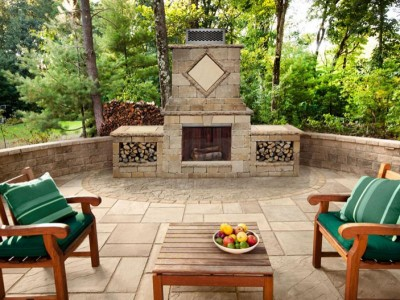 Backyard patio seating area with an outdoor fireplace.