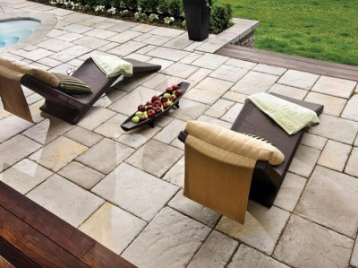 Outdoor patio stones installed with modern furniture.