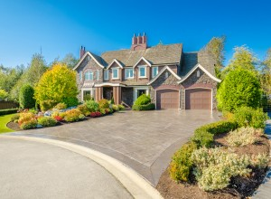 Front of large luxury house with great curb appeal.