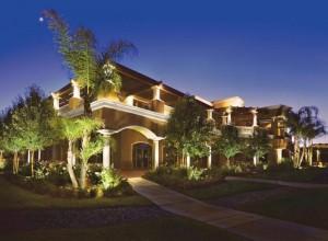 Large modern home with exterior LED landscape lighting.