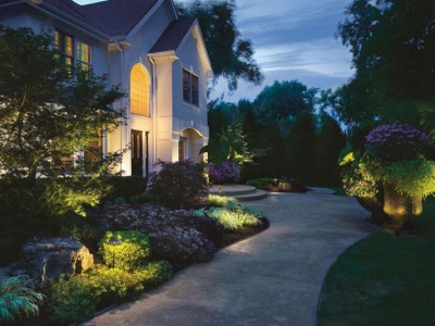 Home with outdoor lighting along a pathway.
