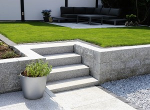 Perfectly landscaped backyard lawn and steps