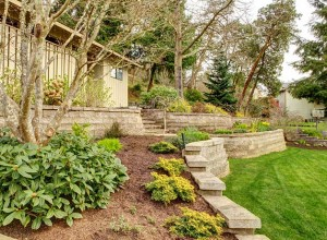 Retaining wall in a beautifully-landscaped backyard space.