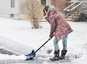 Woman shoveling snow.